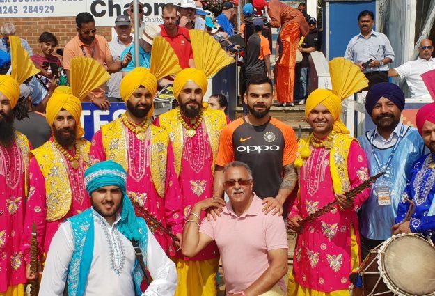 Photo of dancers with world famous batsman and Indian cricket captain Virat Kolhi