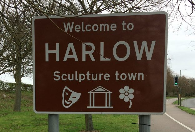 Image of Harlow's town sign, reading 'Welcome to Harlow, Sculpture Town'